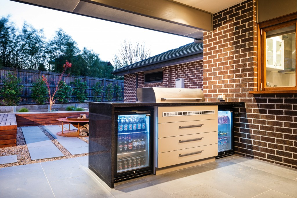 This modest outdoor kitchen serves the family's every need. Photo courtesy of Apex Landscapes.