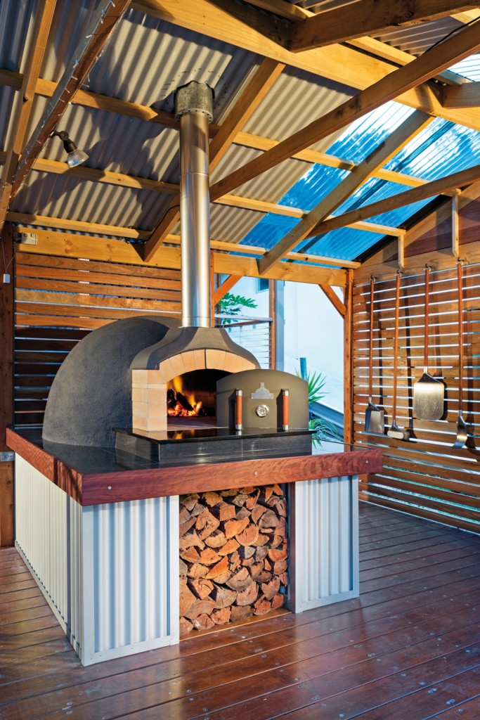 An oven from The Melbourne Fire Brick Company is the focal point of this outdoor kitchen.