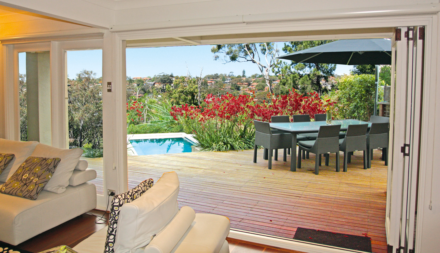 PSS024_Cabanas Feature_attached outdoor room with a view of the pool
