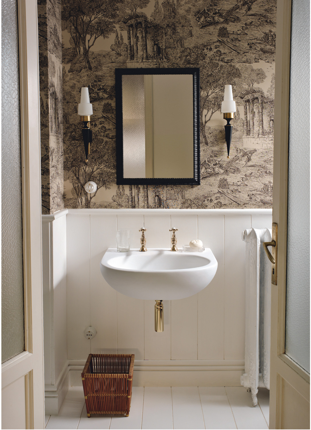 In an interior design that boasts a bold mix of vintage wallpaper, boiserie and off-white hardwood flooring, the Corian Calm washbasin in a sleek shell of Corian Glacier White harmonises perfectly with its surroundings.