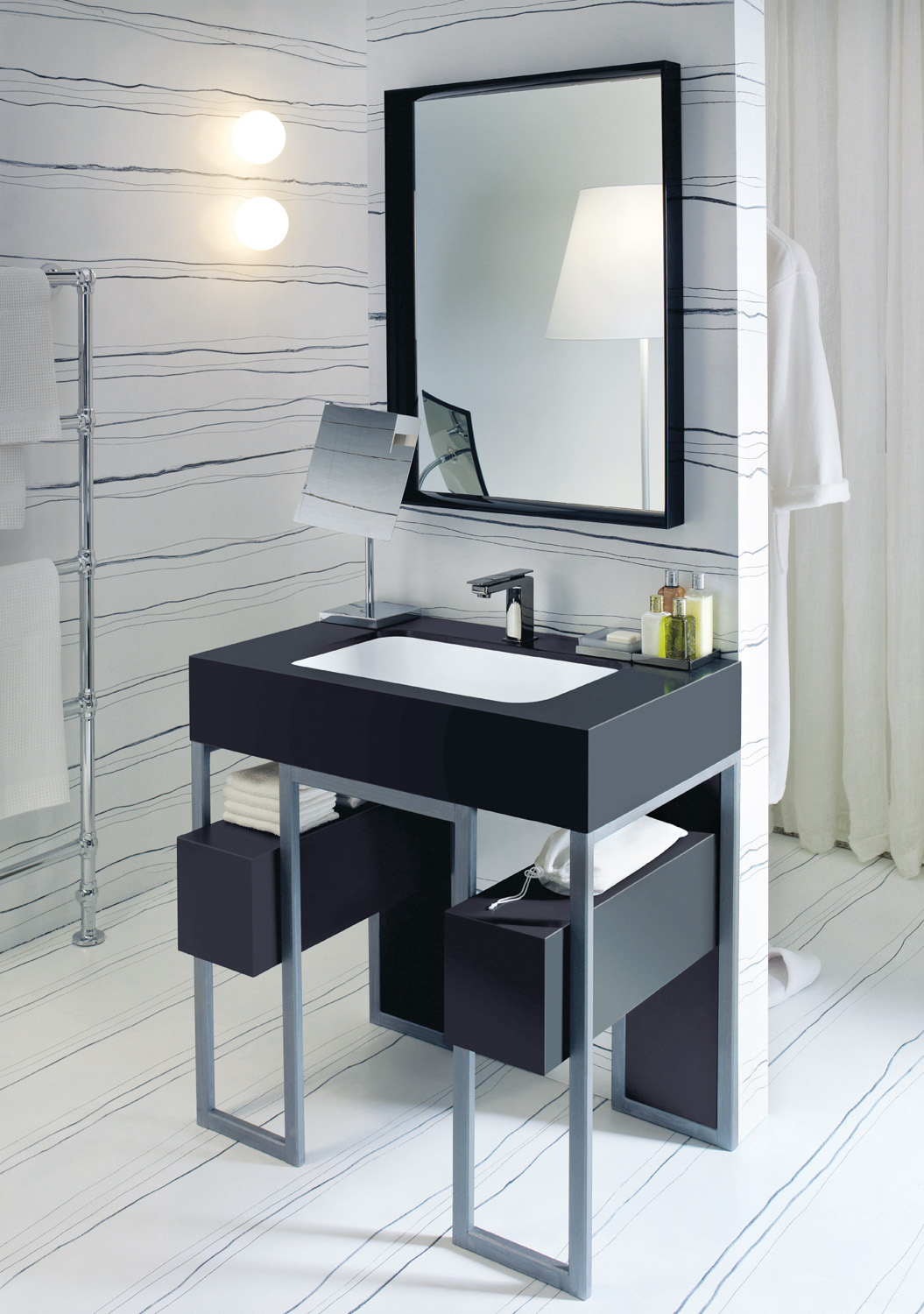 The smooth lines of a Corian Serenity basin installed within a frame of steel and Corian Deep Nocturne create a sophisticated impression. With atmospheric lighting, it becomes the statement centrepiece for a hotel suite or penthouse.