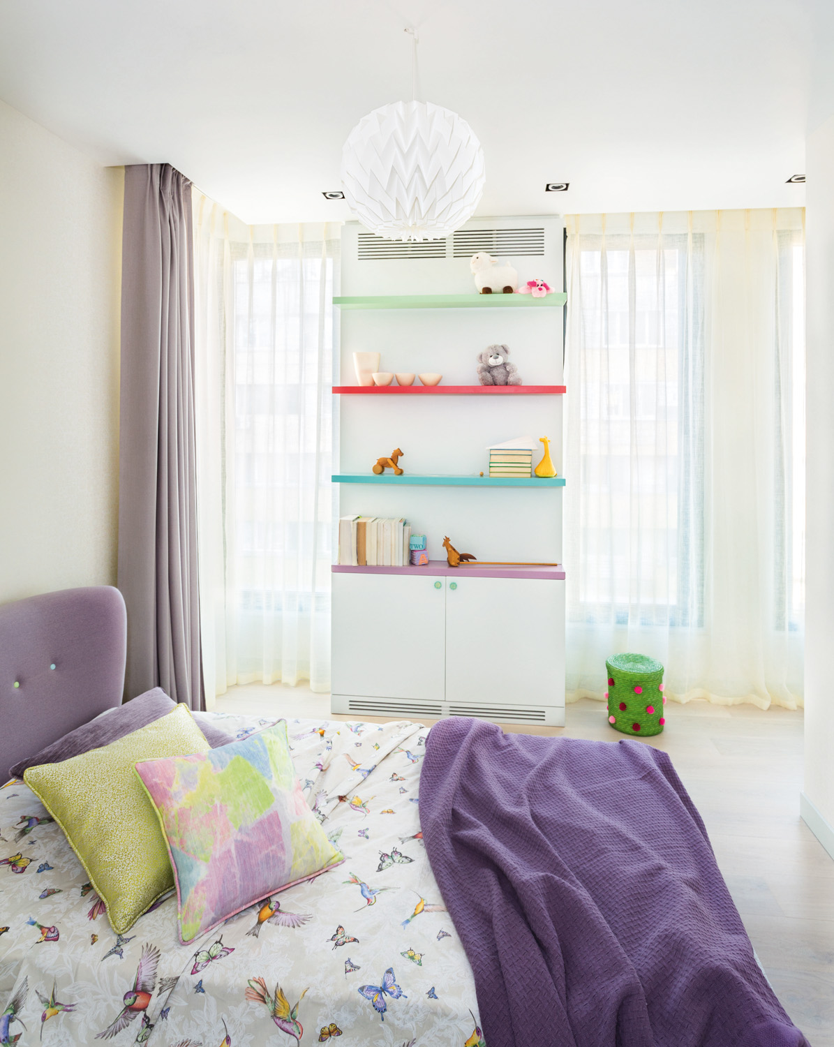 Bright colours balance with white walls and soft drapes