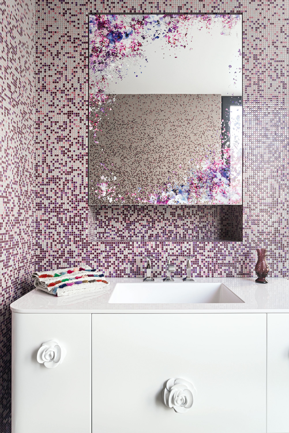 A colourful finish on the bathroom mirror packs a punch