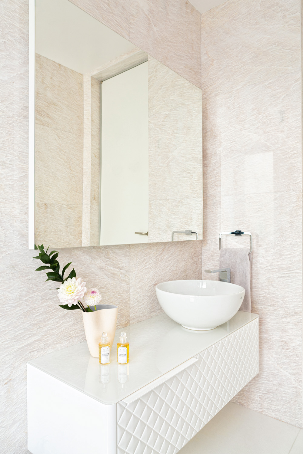A textured vanity brings interest to the calming bathroom