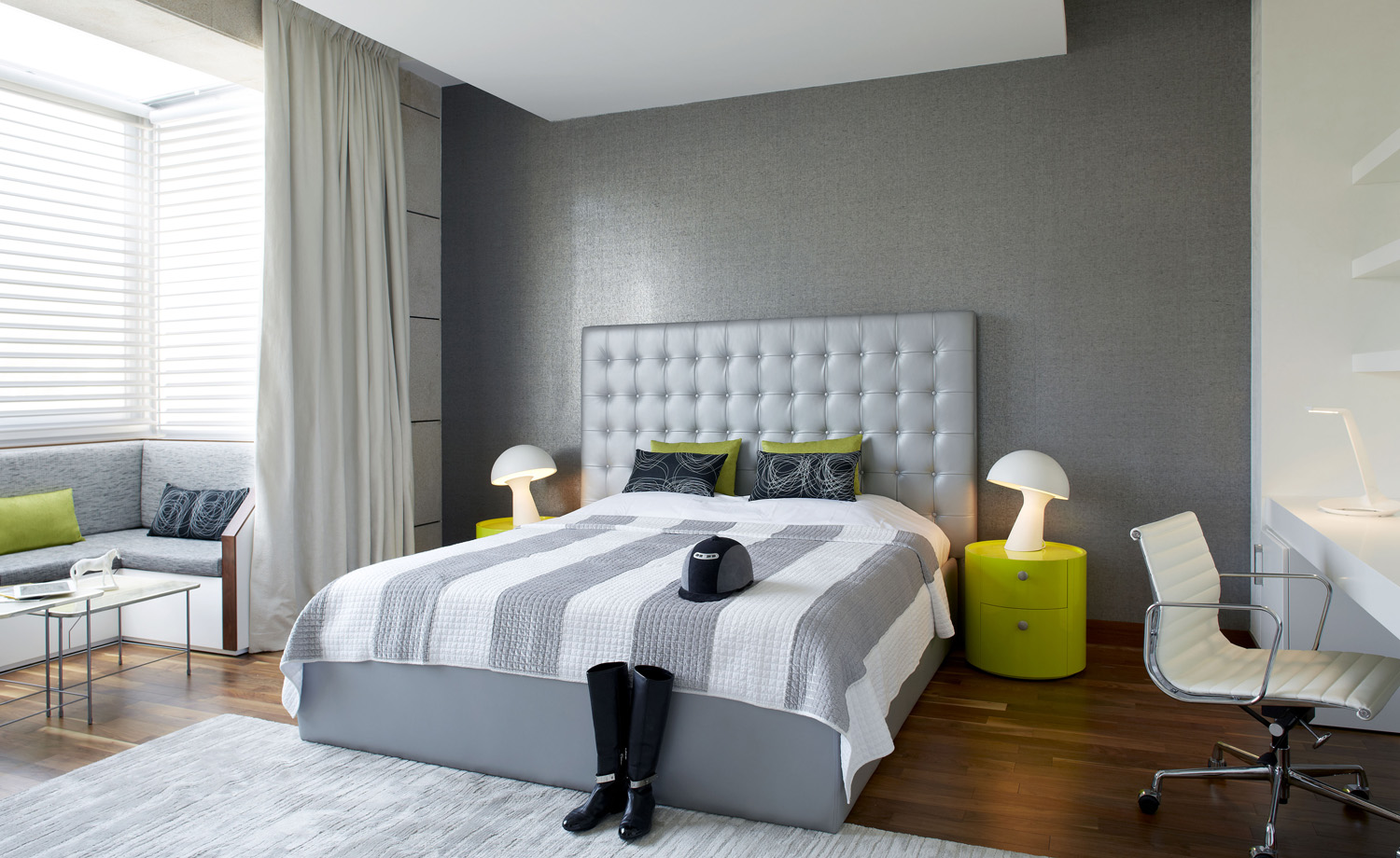 A neutral grey room is livened up by lime accents