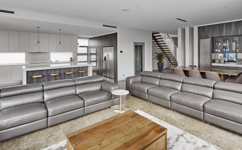 A generous lounge area is just steps away from the kitchen
