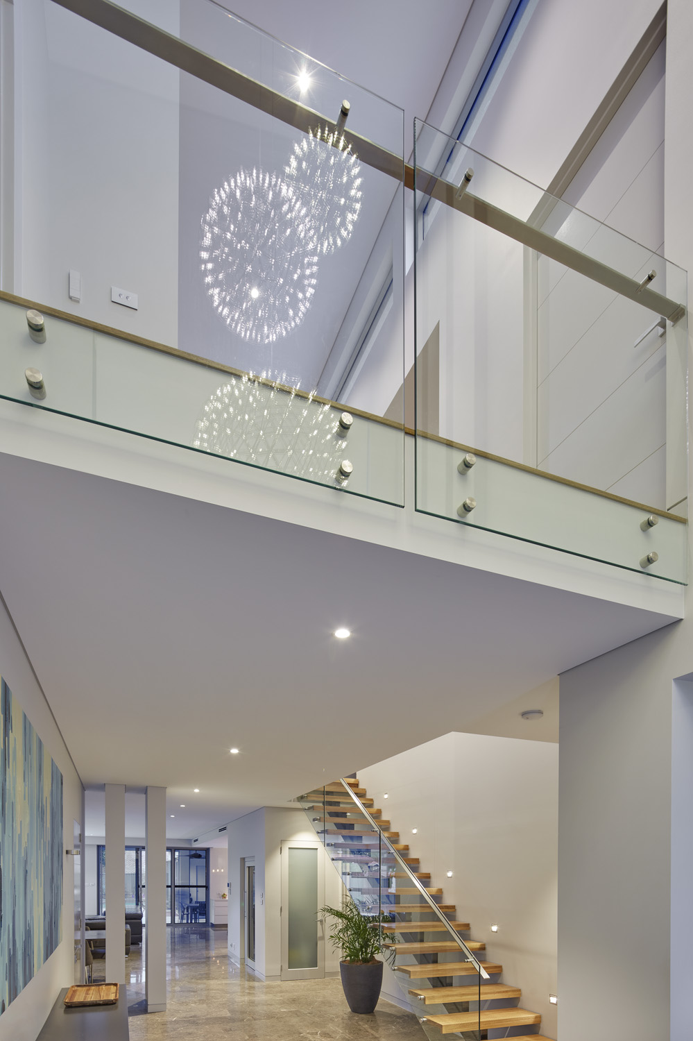 The floating timber staircase is a standout design feature of the home