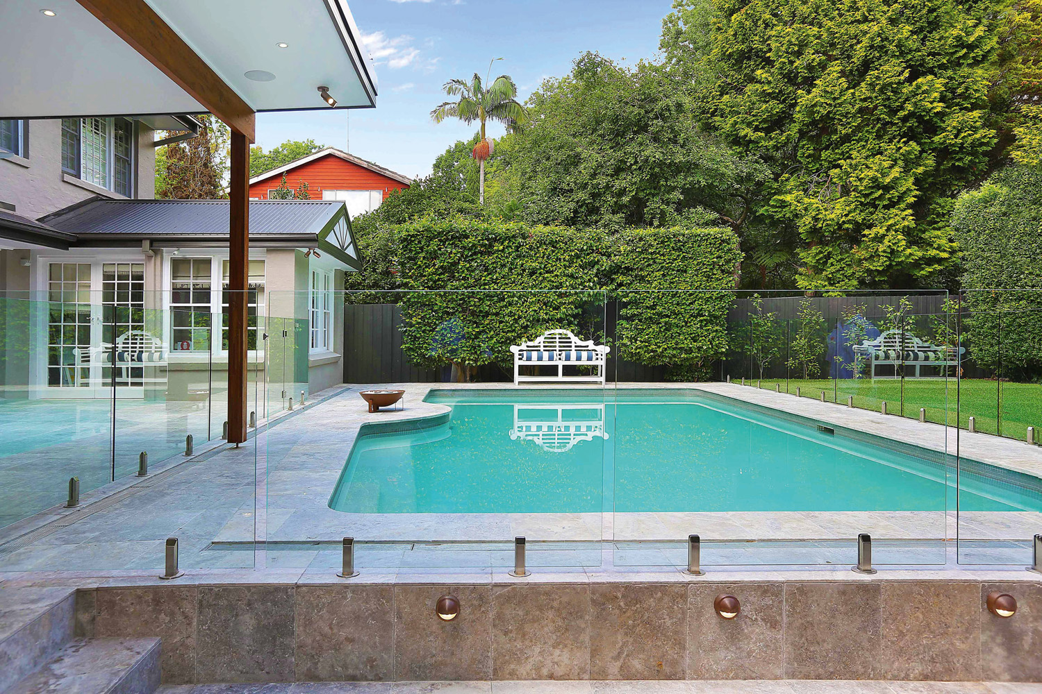 The frameless glass pool fencing ensures clear views around the totally reinvented rear garden