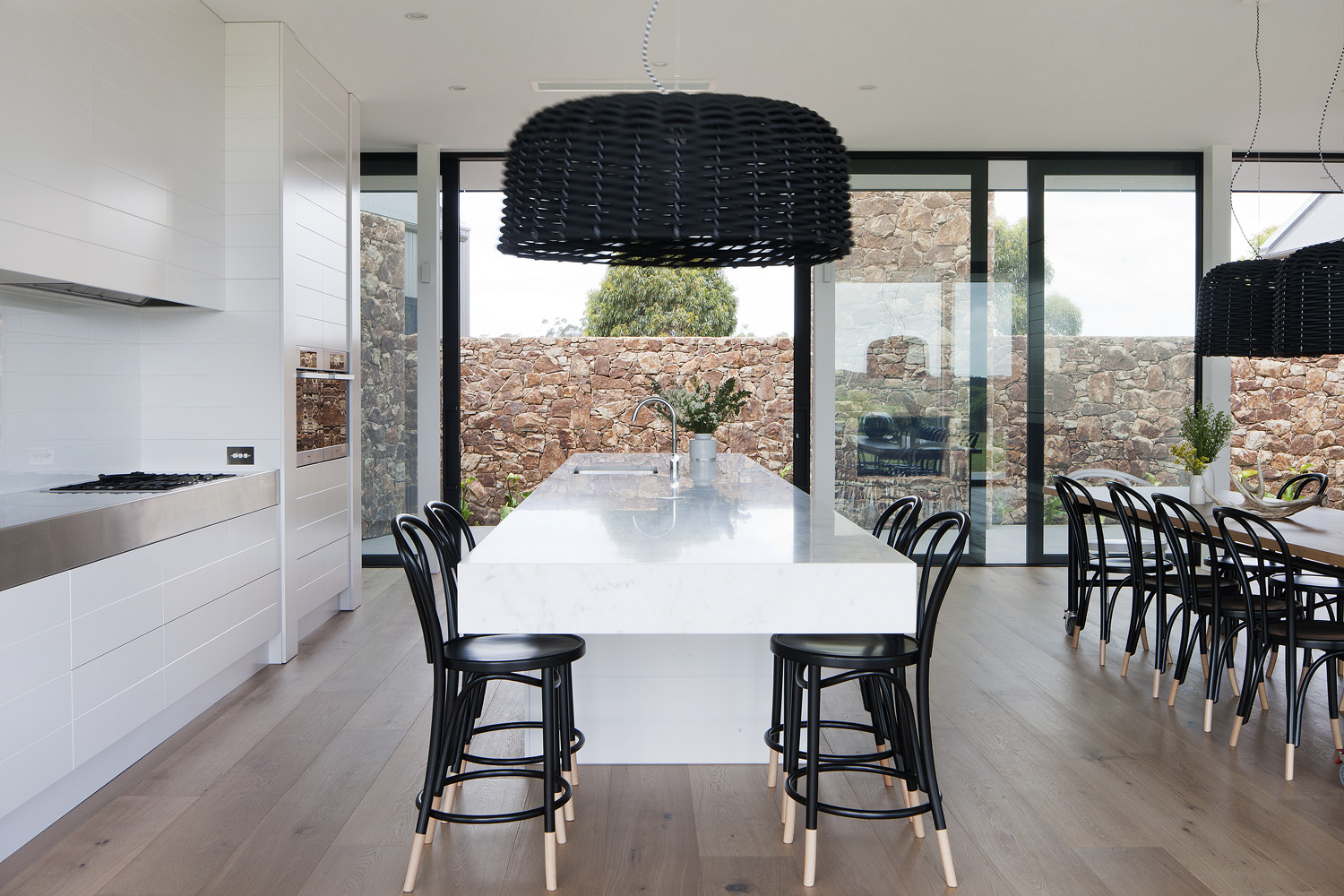 ED'S FAVE A thick stone slab in the kitchen brings a luxe element into the minimalist interior