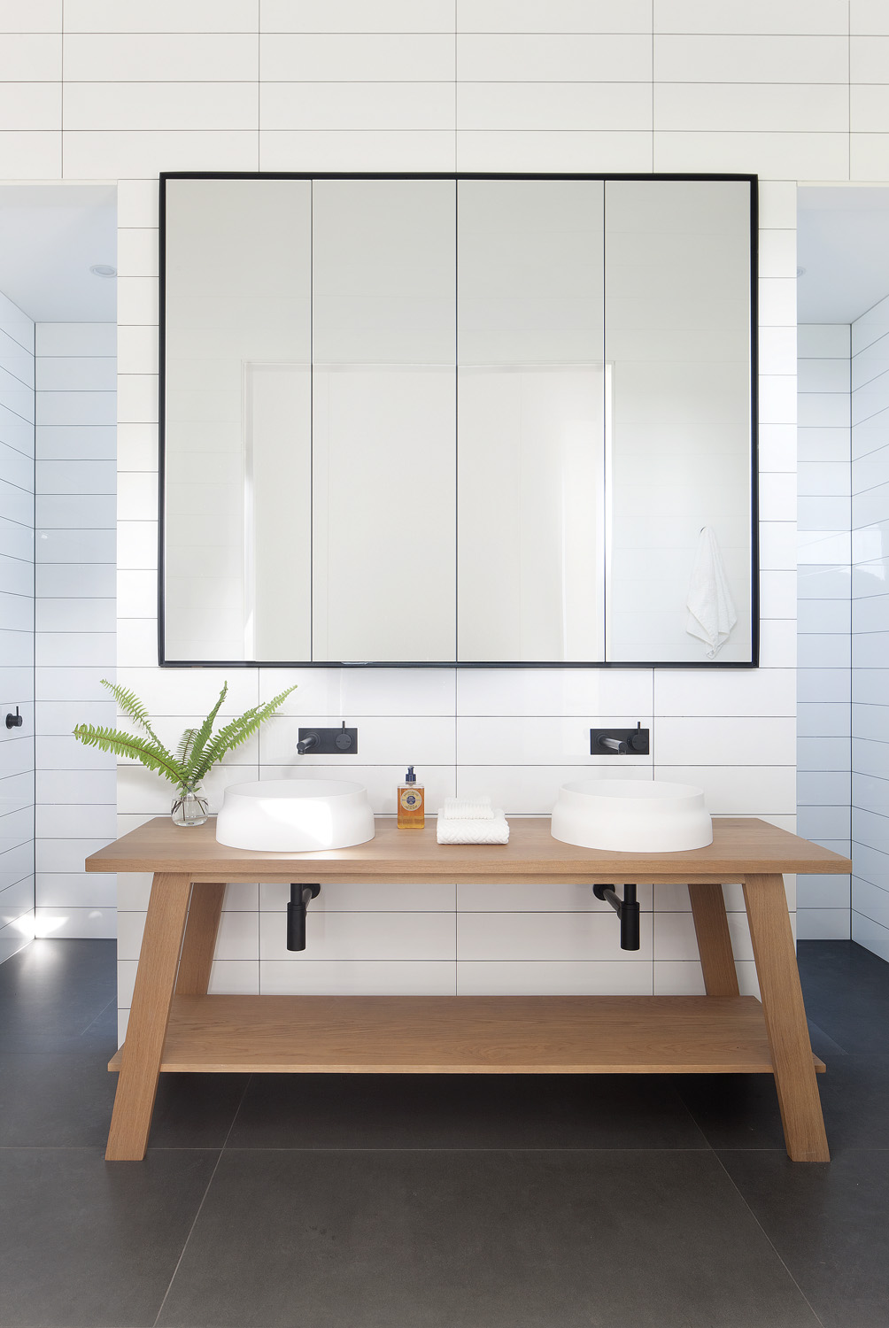 Large-format tiles make the bathroom appear more spacious