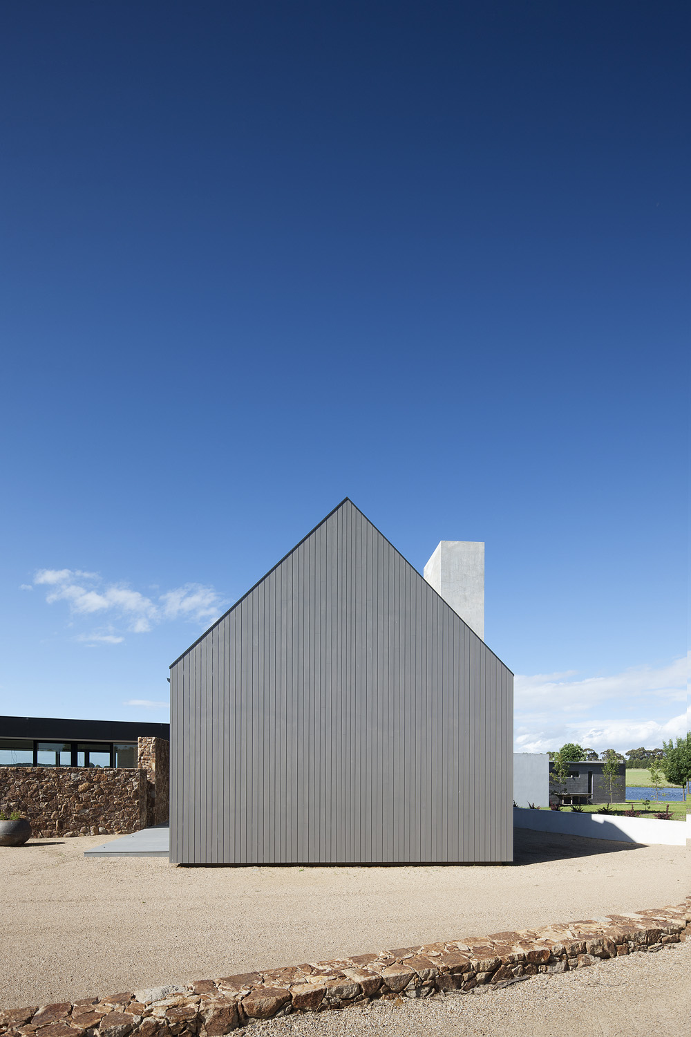WE LOVE The seamless exterior of the  timber-clad barn — simple but effective