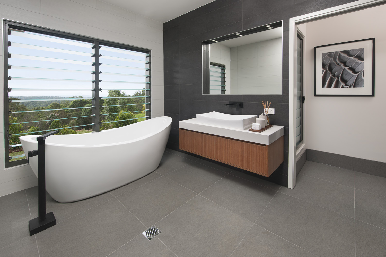 A freestanding tub by the window is a serene spot for relaxation