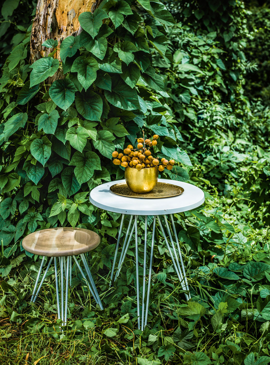 Spike table and low stool.  stylecraft.com.au Gava planter (set of two) and antique brass oval platter. cittadesign.com