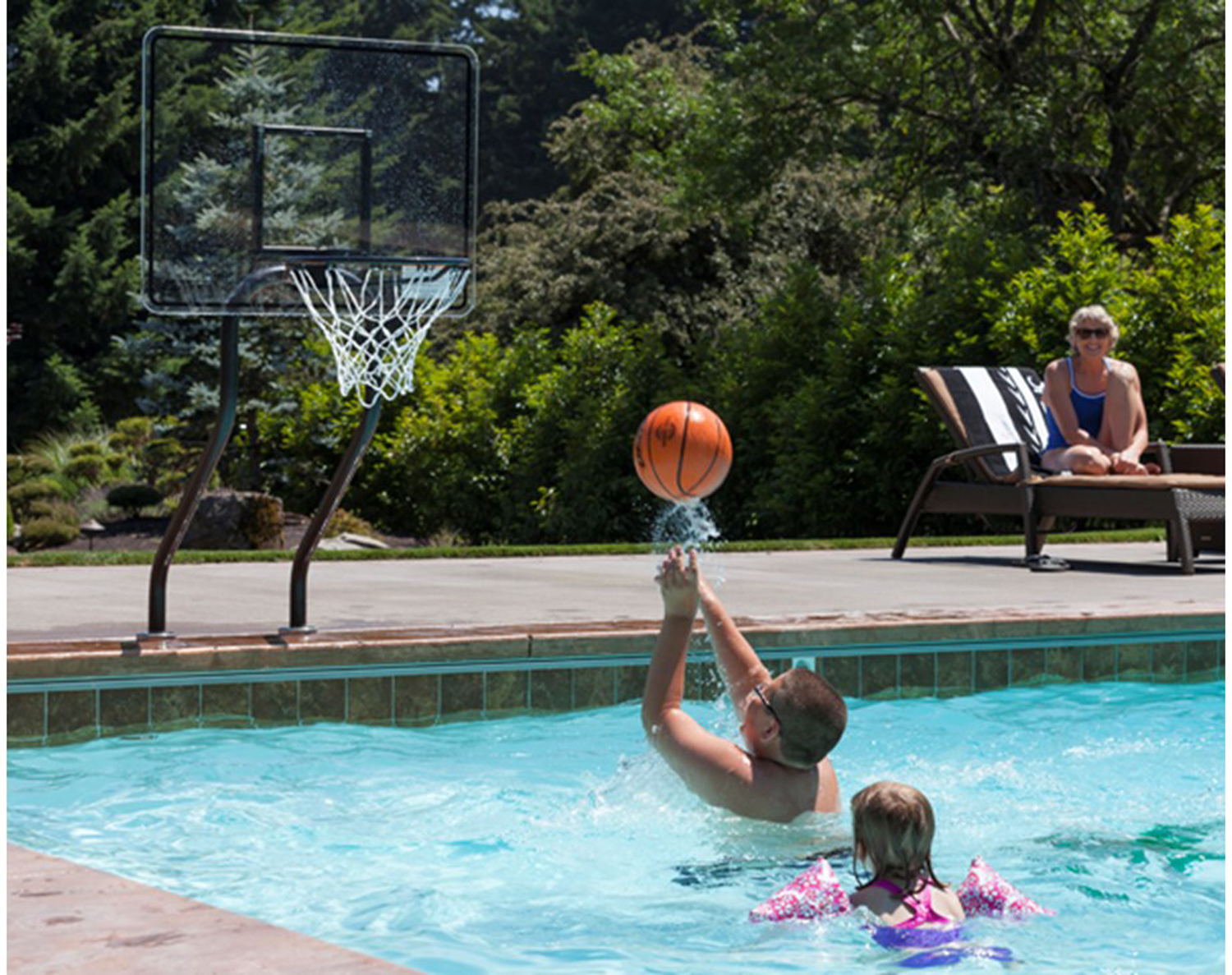 Turning your pool into a playland completehome - Pool basketball ...