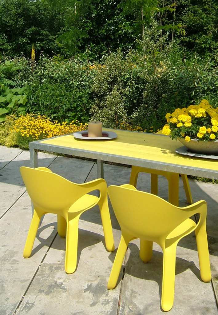 yellow chairs in garden